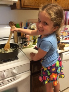 Maya stirring the onions - she loves to help in the kitchen!